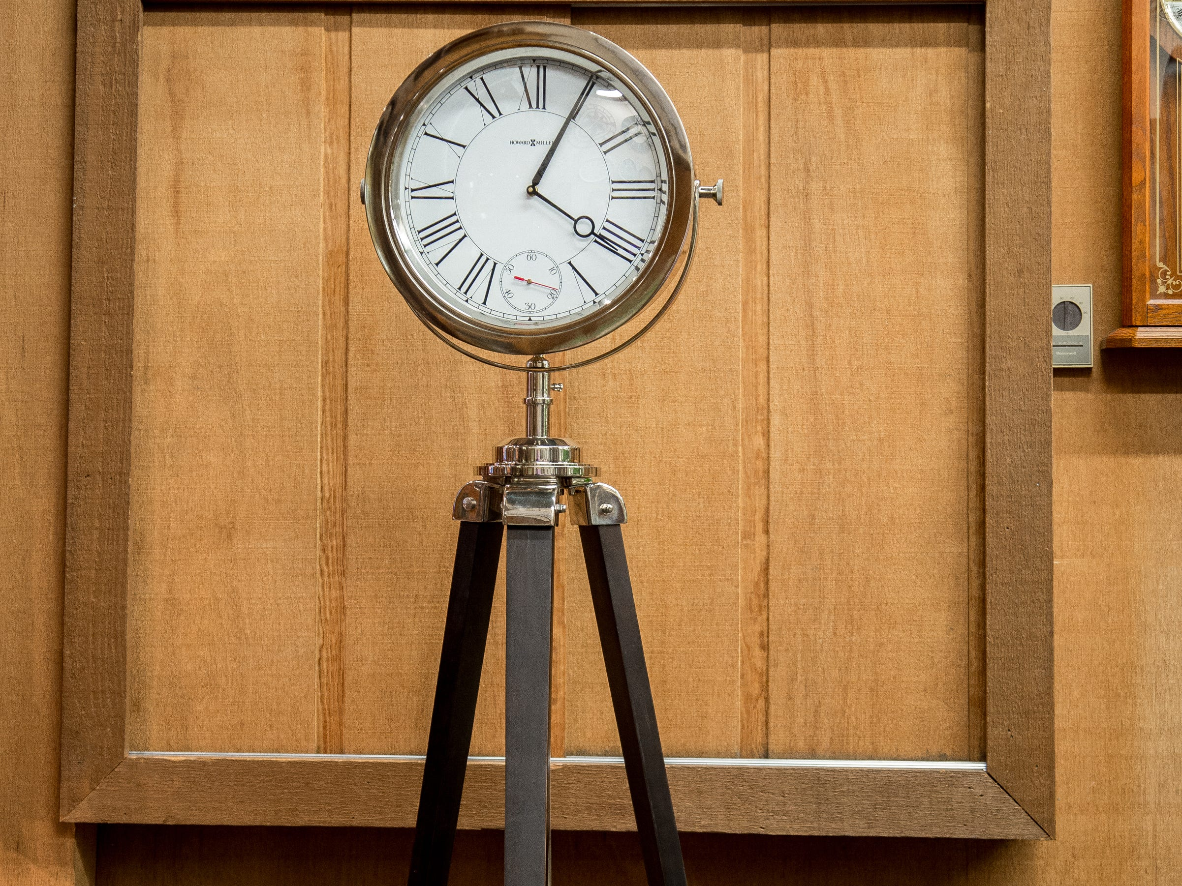 This tripod surveyor-style clock is 71 inches tall and priced at $599 (Little Swiss Clock Shop).