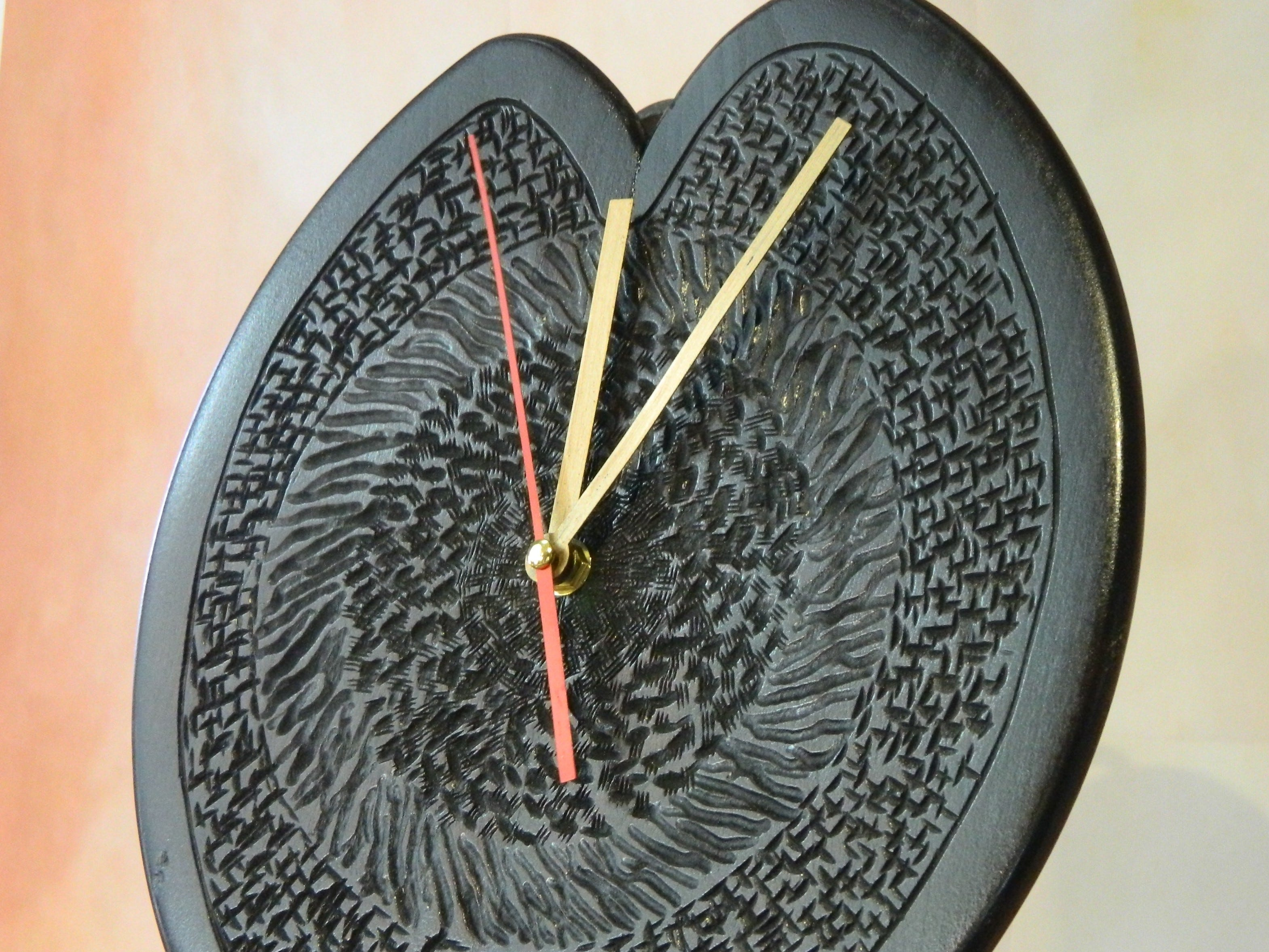 This 12-by-10-inch heart-shaped clock from Tom Woodley ($75) is made of black cherry.