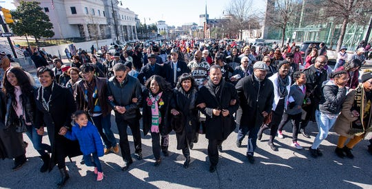 Those attending the Martin Luther King, Jr., birthday celebration march from Dexter Avenue King Memorial Baptist Church to the Alabama State Capitol Building in Montgomery, Ala., on Monday January 21, 2019.