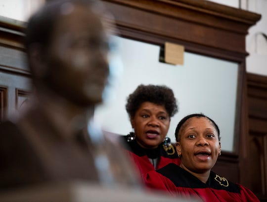 The choir sings as the Martin Luther King, Jr., bust is unveiled at Dexter Avenue King Memorial Baptist Church in Montgomery, Ala., on Monday January 21, 2019.