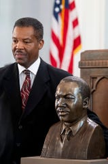 Rev. Cromwell Handy poses with the newly unveiled bust of  Martin Luther King, Jr., during the MLK birthday celebration at Dexter Avenue King Memorial Baptist Church in Montgomery, Ala., on Monday January 21, 2019.