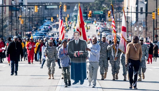 A cutout of Martin Luthert King, Jr., is carried at the front of the parade for MLK day in Montgomery, Ala., on Monday January 21, 2019.