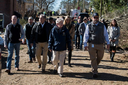 Gov. Kay Ivey tours the tornado damage with other officials in Wetumpka, Ala., on Monday, Jan. 21, 2019.