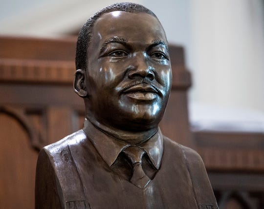 The Martin Luther King, Jr., bust is unveiled at Dexter Avenue King Memorial Baptist Church in Montgomery, Ala., on Monday January 21, 2019.
