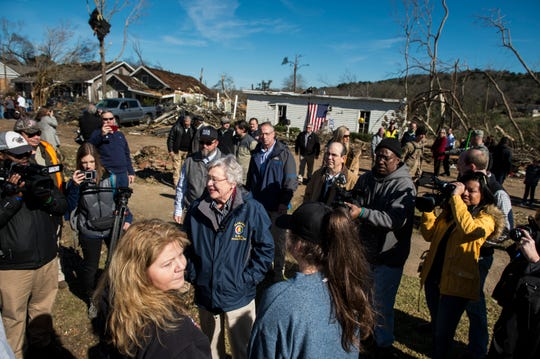 Gov. Kay Ivey speaks with volunteers as she surveys tornado damage in Wetumpka, Ala., on Monday, Jan. 21, 2019.