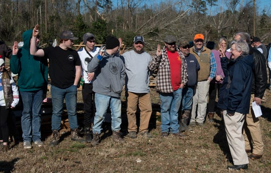 Gov. Kay Ivey meets a Boy Scout troop volunteering to help clean up tornado damage in Wetumpka, Ala., on Monday, Jan. 21, 2019.