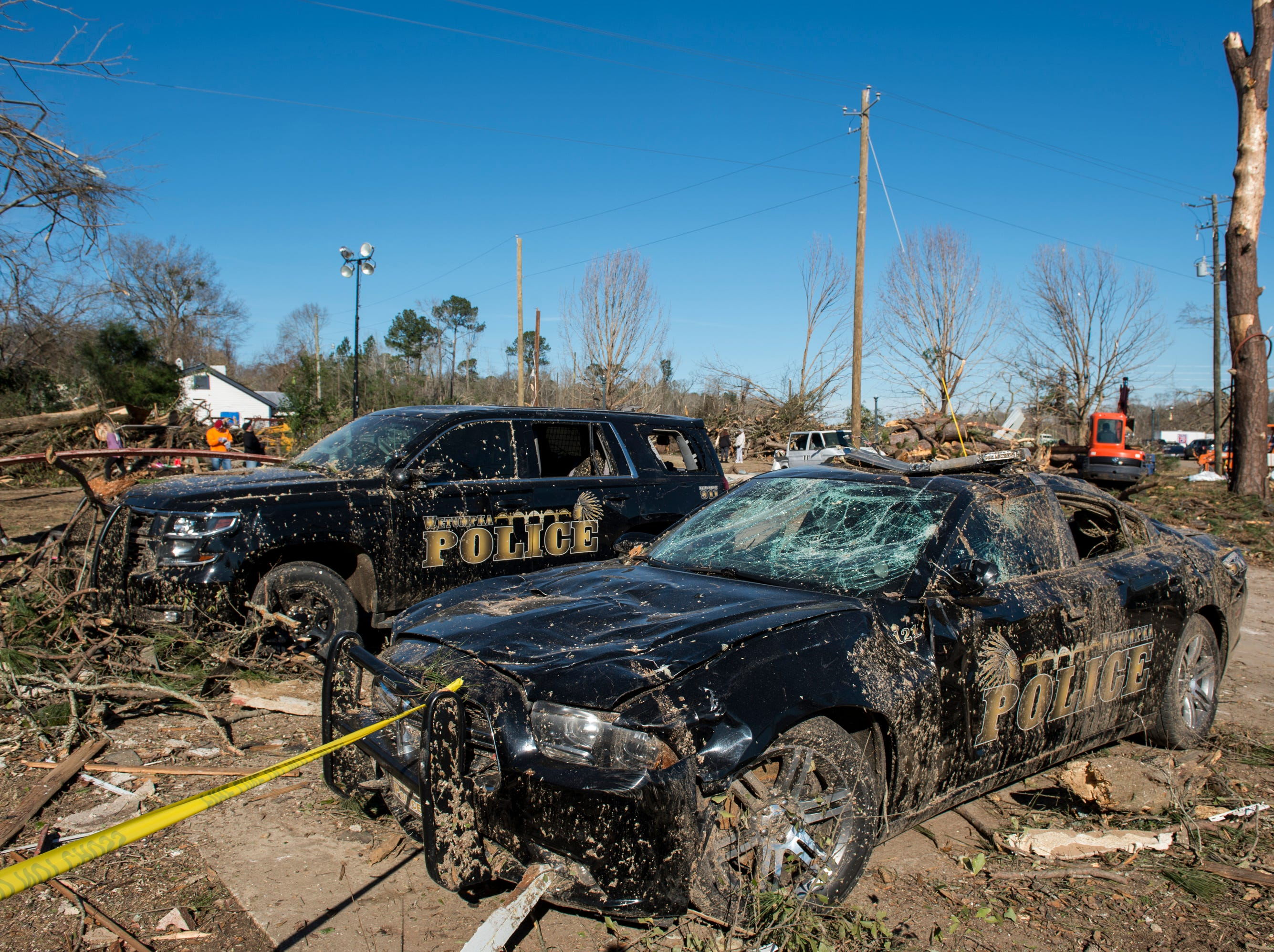 Police cars damaged in Saturday's tornado in Wetumpka, Ala., on Monday, Jan. 21, 2019.