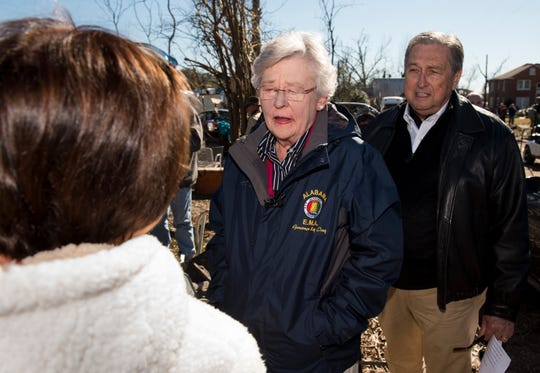 Gov. Kay Ivey and Wetumpka Mayor Jerry Willis speaks with volunteers as she surveys tornado damage in Wetumpka, Ala., on Monday, Jan. 21, 2019.