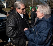 Wetumpka Mayor Jerry Willis greets Gov. Kay Ivey as they survey the tornado damage in Wetumpka, Ala., on Monday, Jan. 21, 2019.