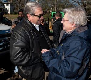 Wetumpka Mayor Jerry Willis greets Gov. Kay Ivey as they survey the tornado damage in Wetumpka, Ala., on Monday, Jan. 21, 2019.