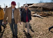 State Sen. Clyde Chambliss, R-Prattville, speaks with Gov. Kay Ivey as they survey tornado damage in Wetumpka, Ala., on Monday, Jan. 21, 2019.