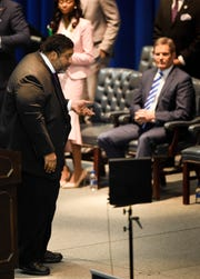 The Rev. William J. Barber turns toward Gov. Bill Lee, seated, as he delivers his sermon at the Martin Luther King Jr. 30th Commemorative Convocation on Monday, Jan. 21, 2019, at Tennessee State University's Gentry Center.