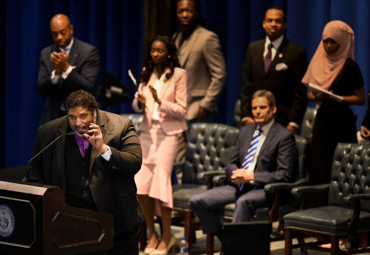 Rev. William J. Barber addresses the audience at the Martin Luther King Jr. 30th Commemorative Convocation TSU's Gentry Center Monday, Jan. 21, 2019, in Nashville, Tenn. Governor Bill Lee sits as he listens to Barber's sermon at the convocation.