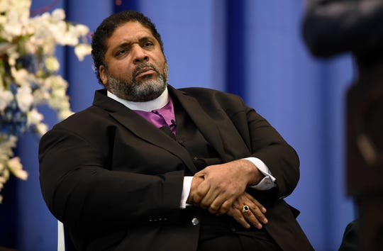 Rev. William J. Barber listens during the Martin Luther King Jr. 30th Commemorative Convocation before delivering his key note address at TSU's Gentry Center Monday, Jan. 21, 2019, in Nashville, Tenn.