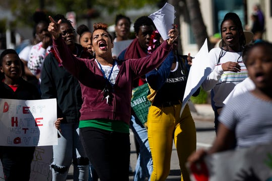 Members of Unity Faith Missionary Baptist Church march in the Martin Luther King Jr. Day parade, organized by the Collier County NAACP, in Naples on Monday, Jan. 21, 2019.