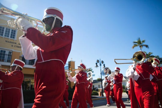 The Immokalee High School marching band marches in the Martin Luther King Jr. Day parade, organized by the Collier County NAACP, in Naples on Monday, Jan. 21, 2019.