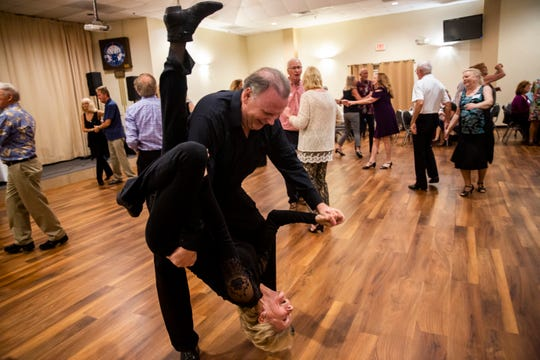 John Middaugh flips Linda Noviello upside down during a dance night held by the Gulf Breeze Bop Club at Elks Lodge in Bonita Springs on Friday, January 18, 2019.