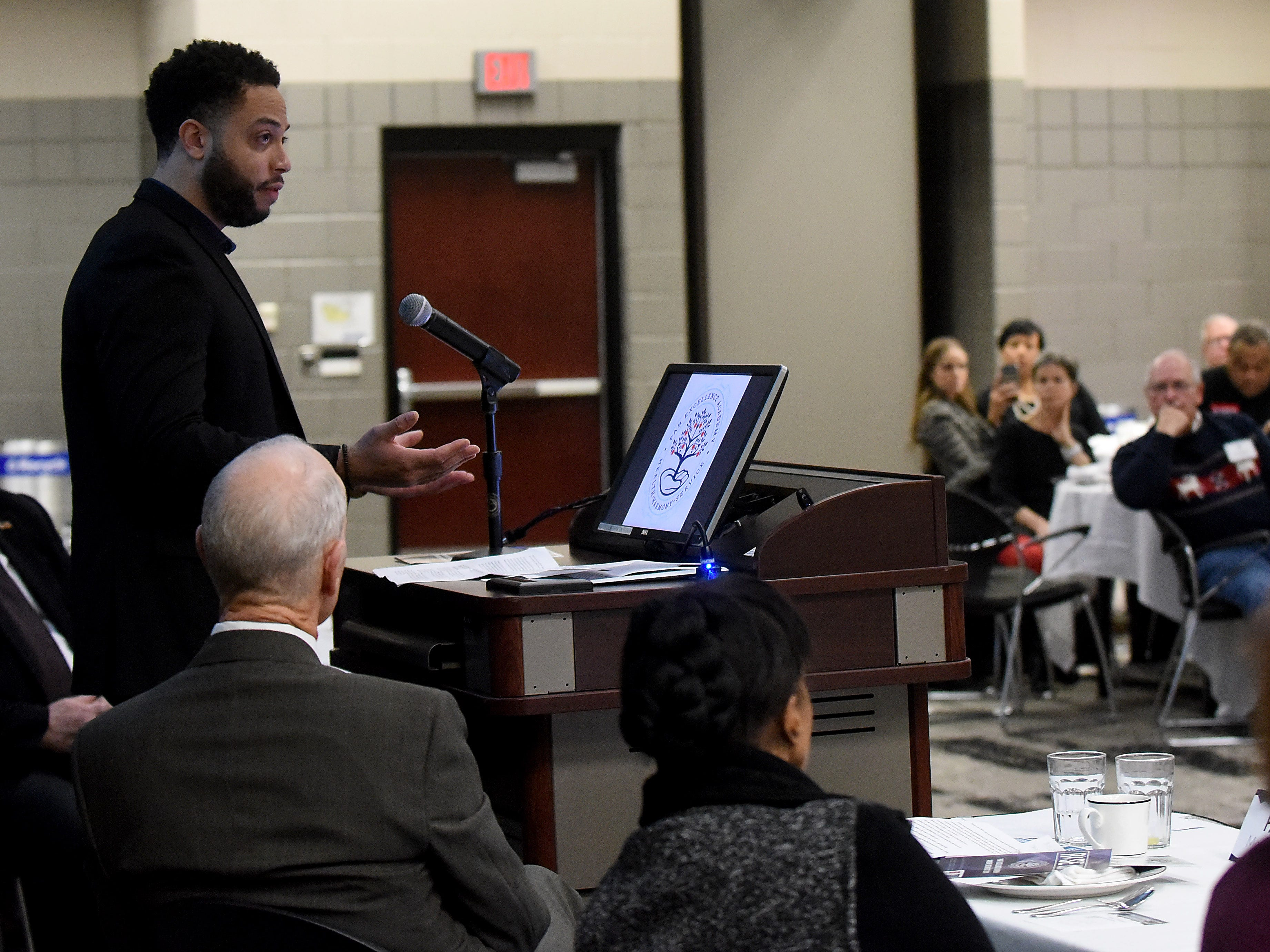 Keynote speaker Christopher B. Noble uses his address to called for a unification of humanity quoting Martin Luther King Jr.'s speech by King at the Hungry Club Forum in Georgia during Par Excellence Academy's annual Martin Luther King Jr. Day breakfast at John Gilbert Reese Center on the campus of OSU Newark.