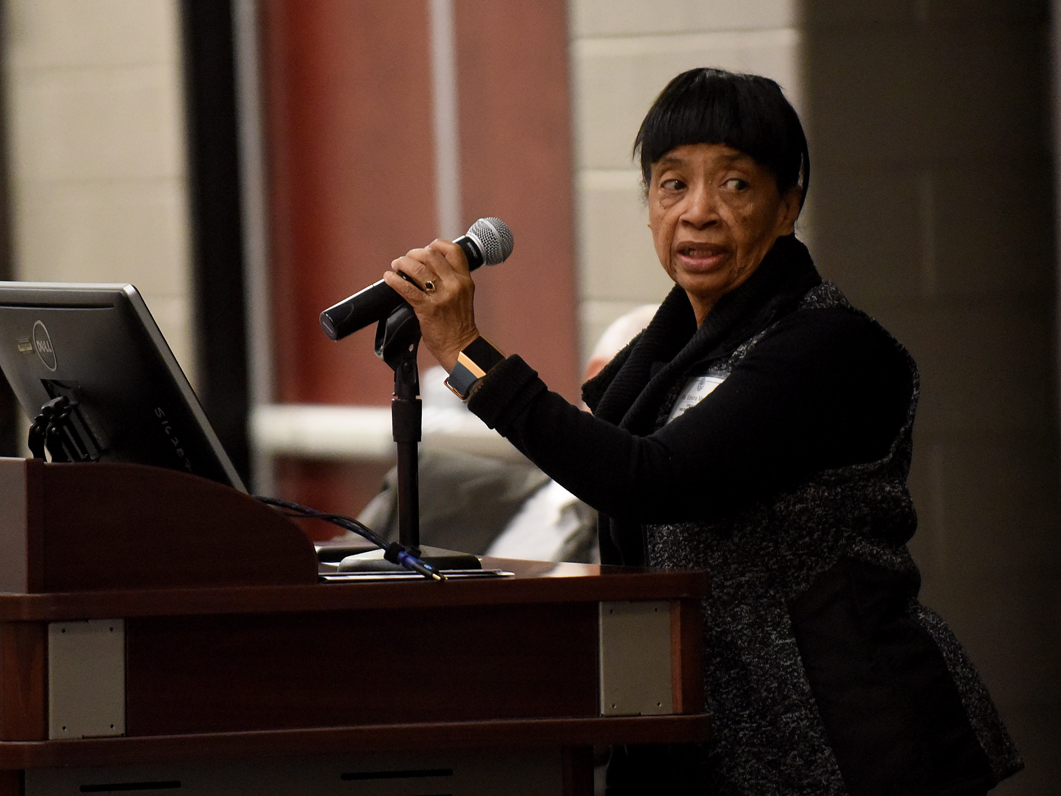 Par Excellence Academy board president Edwina McIntyre introduces the recipient of the Helping Hand Award, Kim Lust, during the school's annual Martin Luther King Jr. Day breakfast at the John Gilbert Reese Center on the campus of OSU Newark.