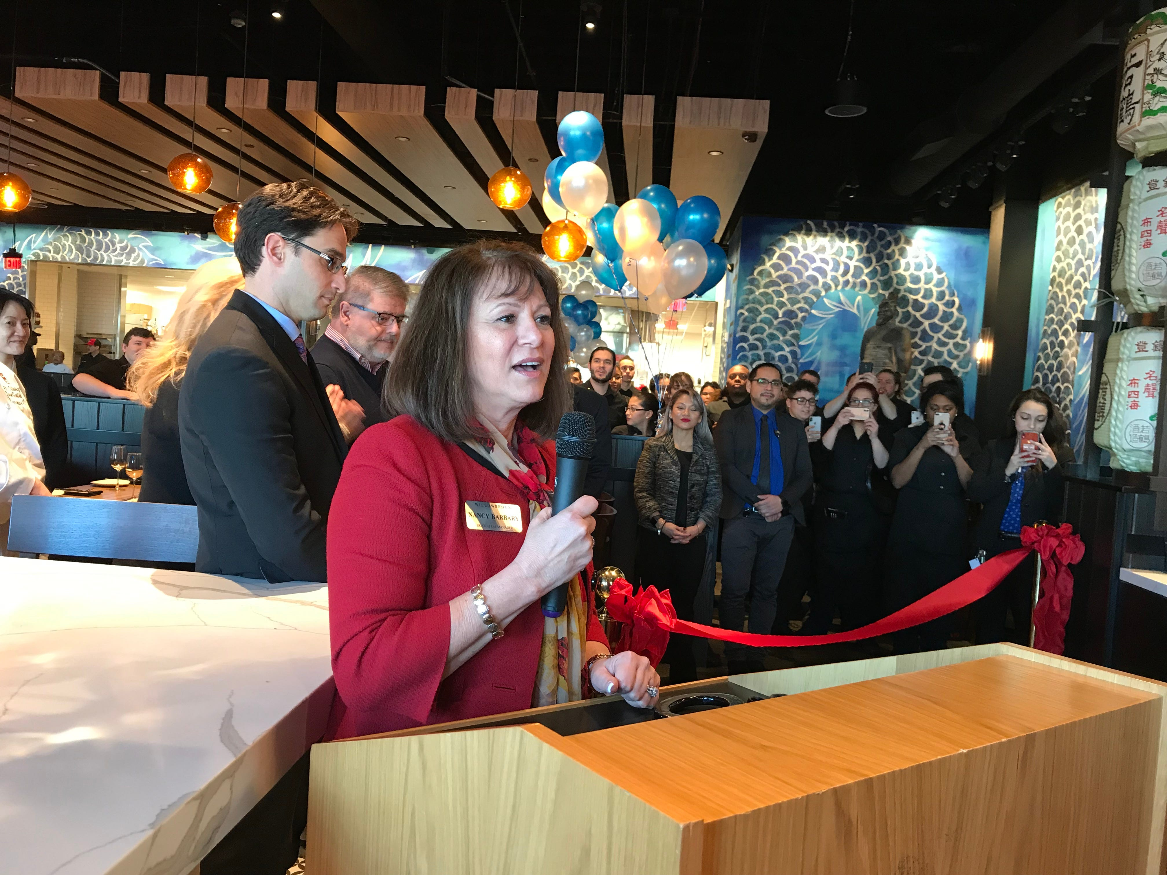 Willowbrook Mall Senior General Manager Nancy Barbary speaks at the opening of the new P.F. Chang's at Willowbrook Mall in Wayne Jan. 21, 2019.
