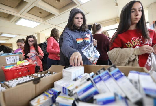Youngsters line up to make sanitary bags for the homeless. The third annual MLK Day of Service for North Jersey students was held at Bergen Community College in Paramus on Monday, January 21, 2019.