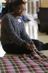 Sanai Betts, 13, of Teaneck, and others made layered blankets for the homeless, seniors and hospitals by cutting the ends of one and tying it to another. The third annual MLK Day of Service for North Jersey students was held at Bergen Community College in Paramus on Monday, January 21, 2019.