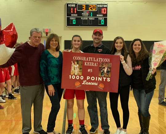 Lakeland junior Keira Marks is joined by her family after scoring her 1,000th career point in the Lancers' 56-42 girls basketball win at Bergen Tech on Thursday, Jan. 17, 2019. Marks netted 16 points in the game to raise her career total to 1,013.