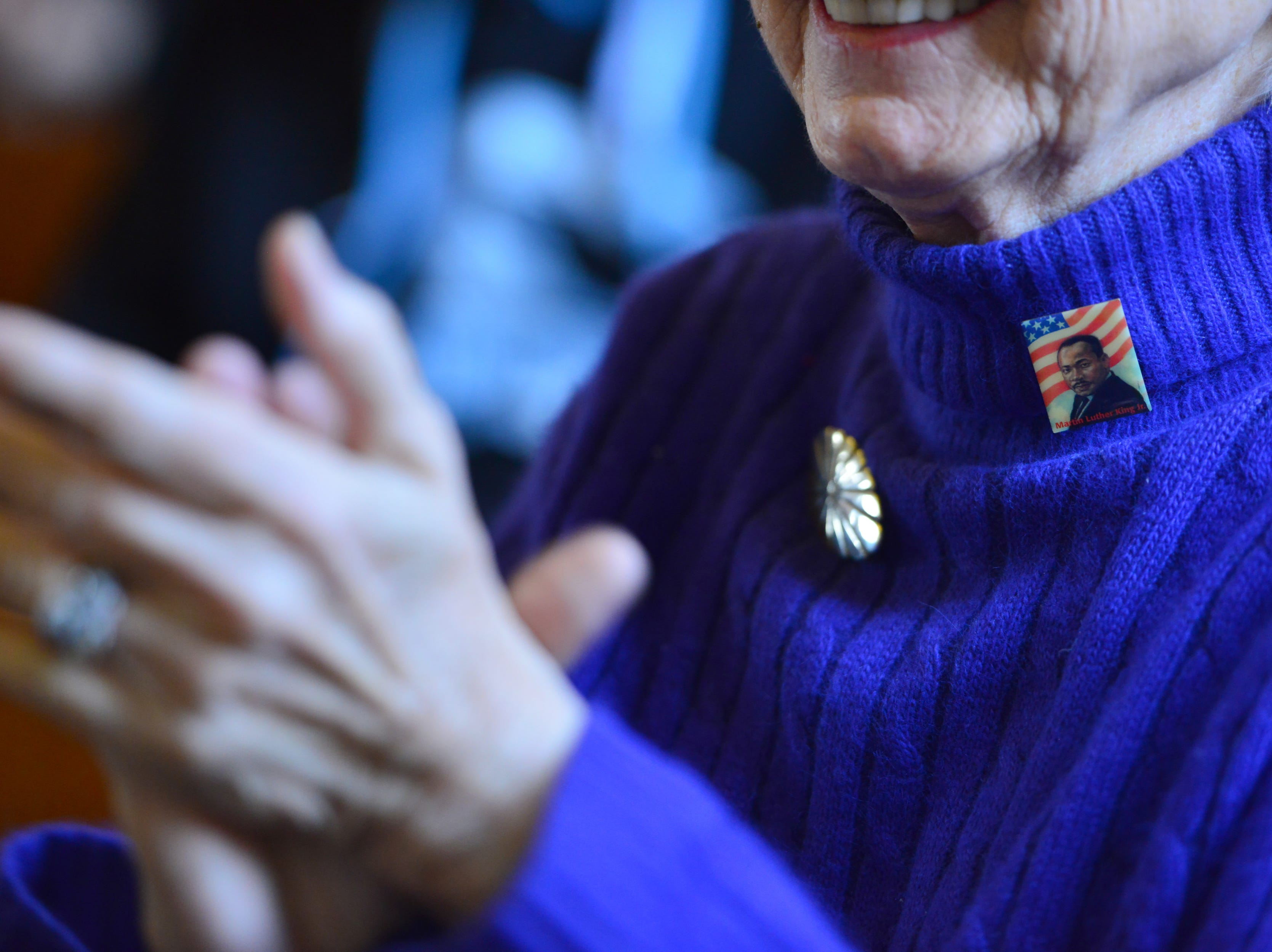 Jeri Cohn, of Ridgewood, N.J., sings at the start of the service with a pin of a portrait of Dr. King on her sweater. The Ridgewood United Methodist Church held its 37th year of honoring Dr. Martin Luther King, Jr. in Ridgewood, on Monday January 21, 2019. Area residents and religious leaders from many faiths attended the annual event.