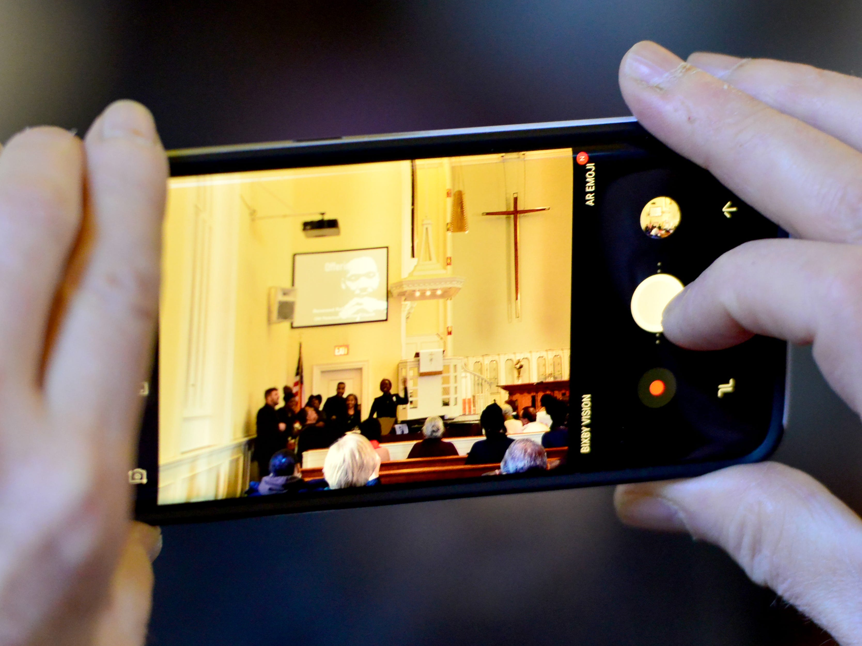 A man uses his cell phone to record part of the  performance of Rev. Mark Brandon and The Connection of Metropolitan A.M.E. Zion Church, of Ridgewood, N.J. at the Ridgewood United Methodist Church, which held its 37th year of honoring Dr. Martin Luther King, Jr. in Ridgewood, on Monday January 21, 2019. Area residents and religious leaders from many faiths attended the annual event.