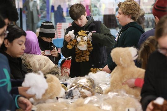 Mark Morea, 12, of Glen Rock makes teddy bears by putting the stuffing inside. The third annual MLK Day of Service for North Jersey students was held at Bergen Community College in Paramus on Monday, January 21, 2019.