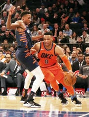 Oklahoma City Thunder guard Russell Westbrook (0) dribbles the ball against New York Knicks guard Frank Ntilikina (11) during the first half at Madison Square Garden.