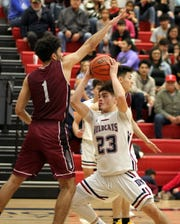 Senior Wildcat post Demetri Maldonado (23) held his own against a taller Gadsden Panthers front line. Maldonado would finish with six points and seven rebounds.