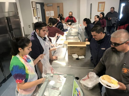 Community members had breakfast with the band and choir at Deming High School. Deming High Band and Choir students served breakfast to the community Saturday as part of fundraising efforts for a future band trip to a Dallas music festival. Pancakes, sausage & eggs for $5 was well attended in the new DHS cafeteria.