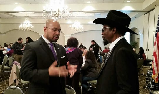 University of Rhode Island Professor Sean E. Rogers, left, keynote speaker at the 2019 Doña Ana County NAACP MLK Breakfast, talks with Howard Guion of Las Cruces during the Monday, Jan. 21 event. Rogers, a former New Mexico State University faculty member, says he hoped to highlight key aspects of Martin Luther King Jr.'s work toward the end of his life.