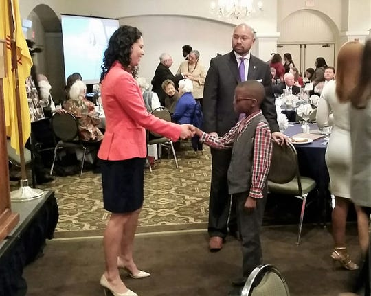 U.S. Rep. Xochitl Torres Small, D-New Mexico, left, shakes hands with a young attendee at the 2019 Doña Ana County NAACP MLK Breakfast, held Monday, Jan. 21 in Las Cruces.