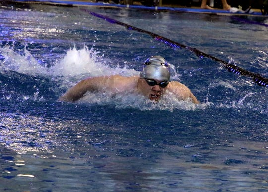 Carlsbad's Jared Rea swims the 100 yd butterfly during Saturday's meet.