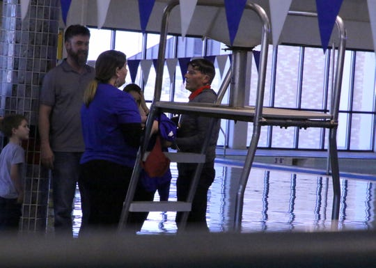 Clayton McCall, right, talks with Carlsbad swim coach Brandy Ackland after McCall dove in the pool to help save an Alamogordo swimmer during the Jan. 19 meet.