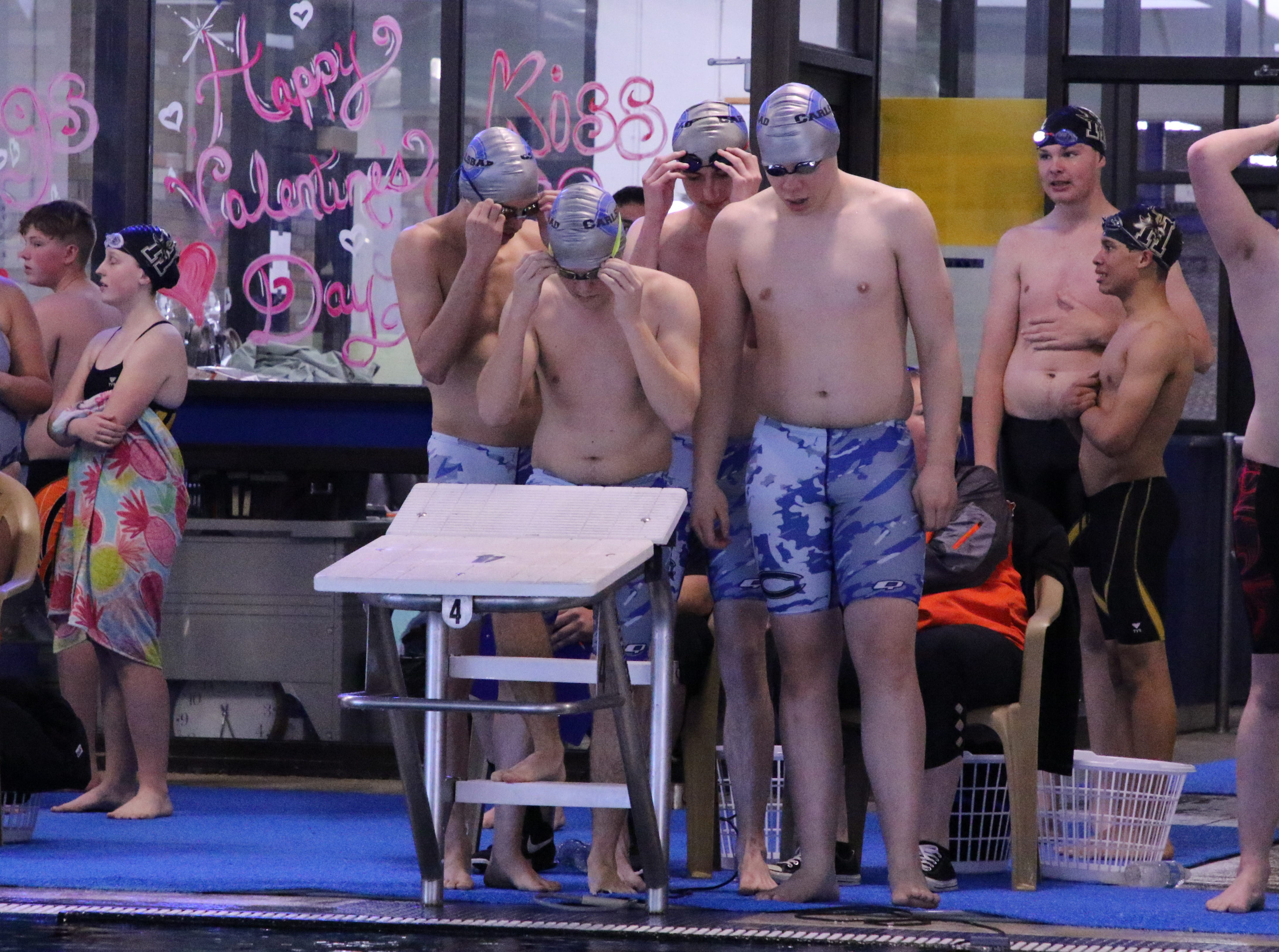 The foursome of Carlsbad's o	Zach McAlister, Jacob DeMichele, Jared Rea,   and Matthew Pavlik all get ready for their team medley race.