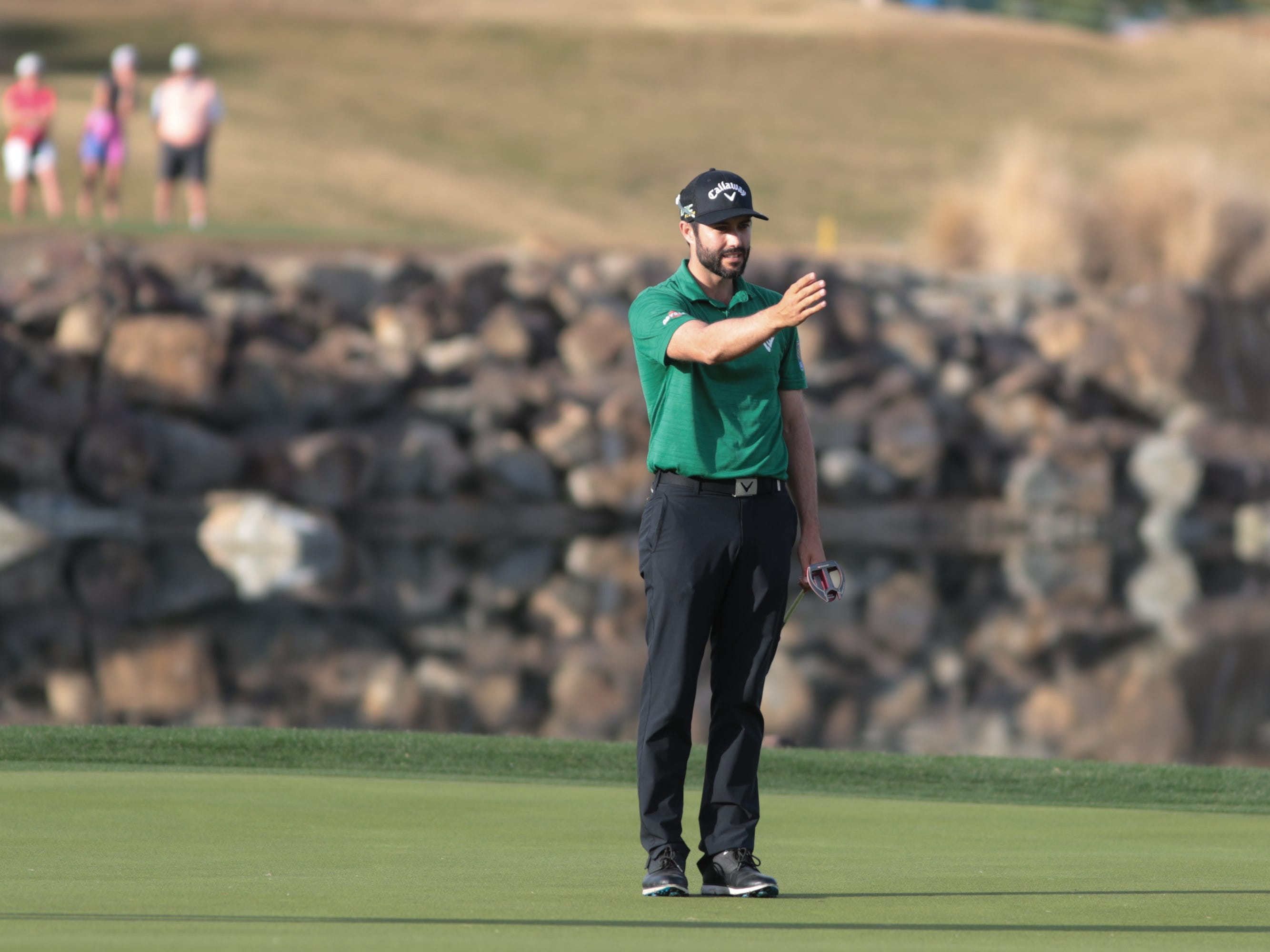 Adam Hadwin prepares to putt on the 17th hole of the 2019 Desert Classic, Sunday, January 20, 2019.