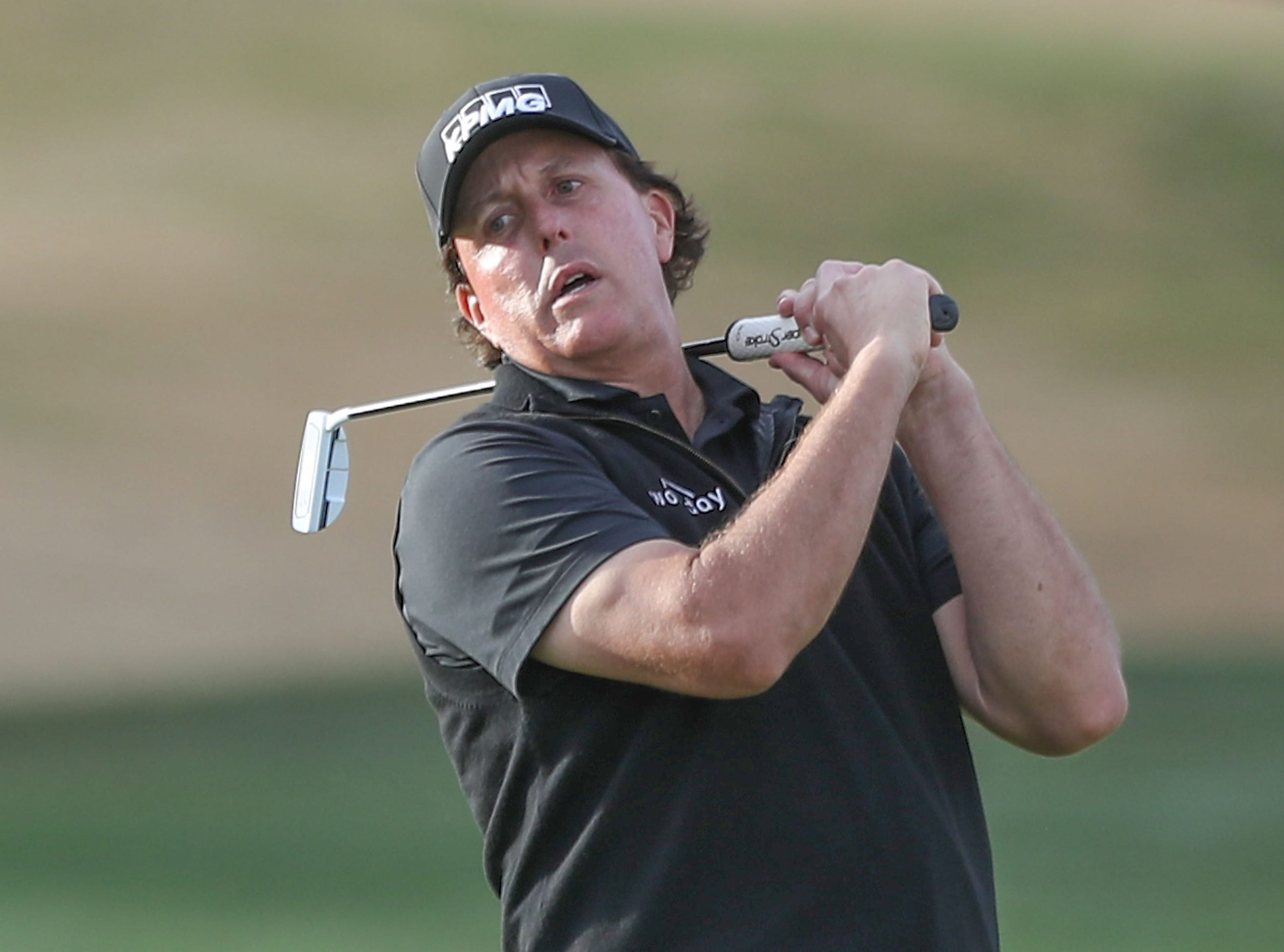 Phil Mickelson reacts to missing a putt on the 18th hole of the Stadium Course at PGA West during the Desert Classic, January 20, 2019.