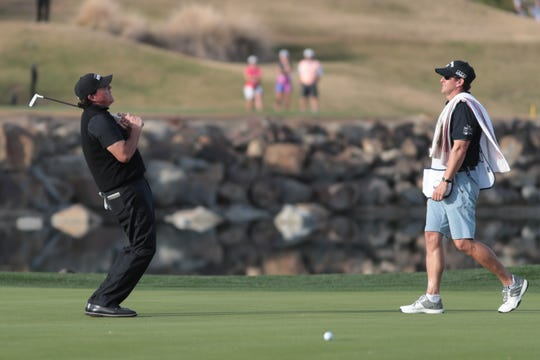 Phil Mickelson reacts after missing a putt on the 17th green of the 2019 Desert Classic, Sunday, January 20, 2019.