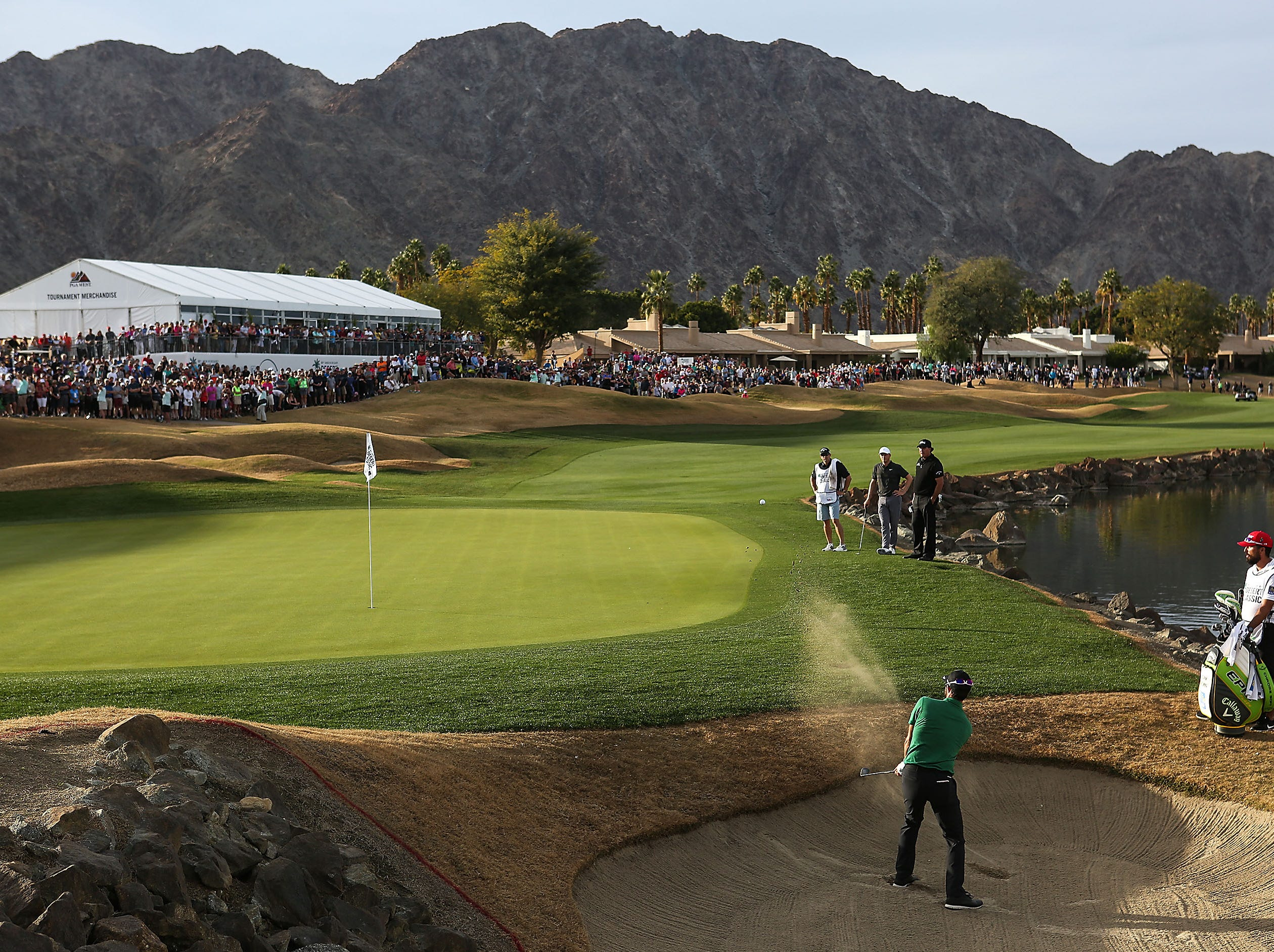 Adam Hadwin hits out of the bunker on the 18th hole of the Stadium Course at PGA West during the Desert Classic, January 20, 2019.