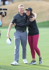 Adam Long gets a hug from his wife after winning on the 18th hole of the Stadium Course at PGA West during the Desert Classic, January 20, 2019.