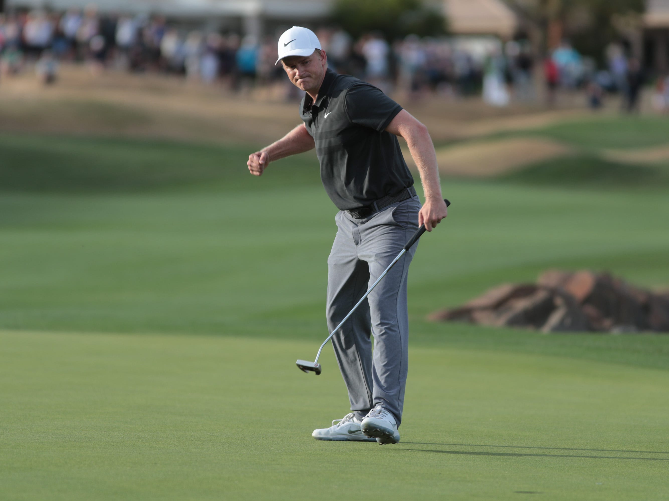 Adam Long reacts to making a birdie putt on the 18th hole of the 2019 Desert Classic, Sunday, January 20, 2019.