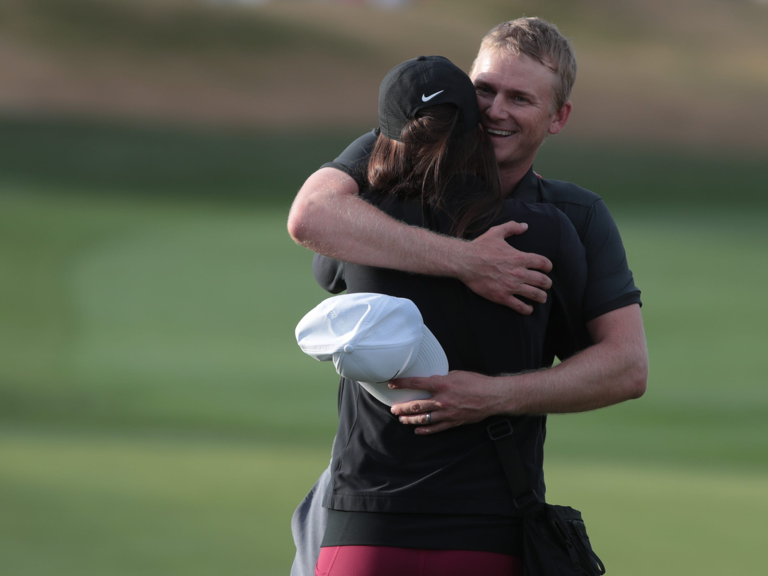 Adam Long celebrates with his wife, Emily Long, after winning the 2019 Desert Classic, Sunday, January 20, 2019.