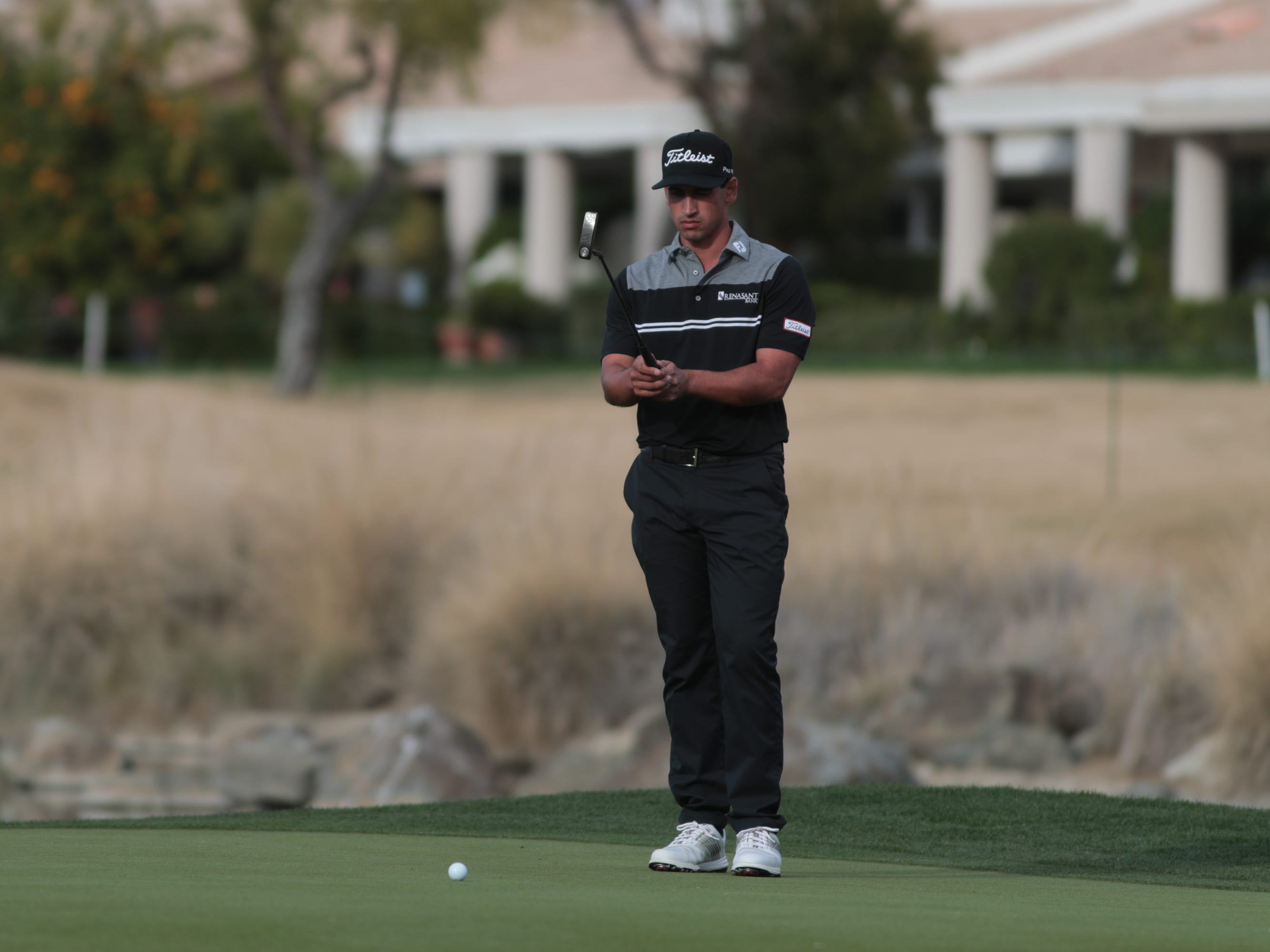 Dominic Bozzelli prepares for a putt on the 17th hole of the 2019 Desert Classic, Sunday, January 20, 2019.