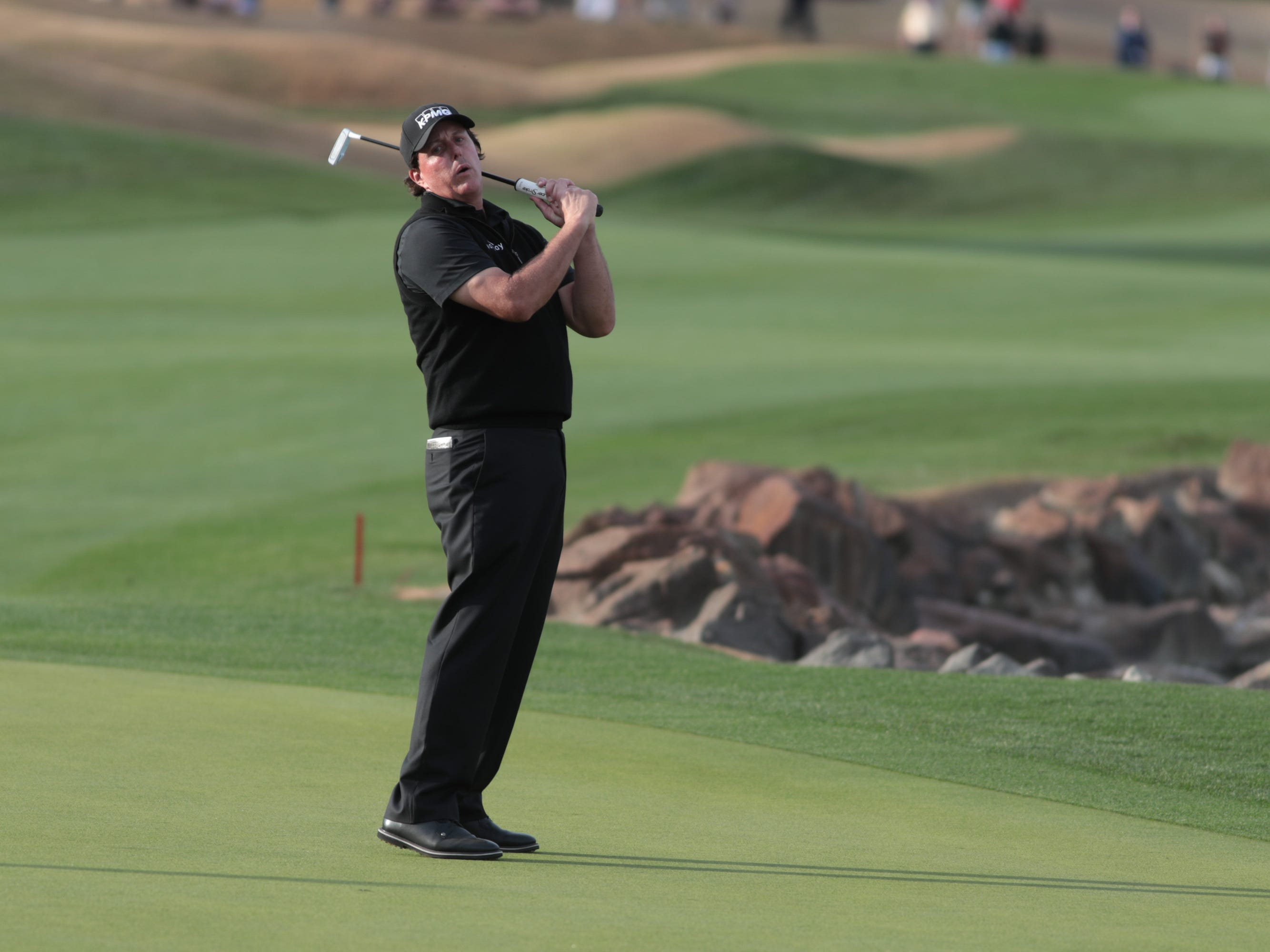 Phil Mickelson reacts after missing a birdie putt on the 18th hole of the 2019 Desert Classic, Sunday, January 20, 2019.
