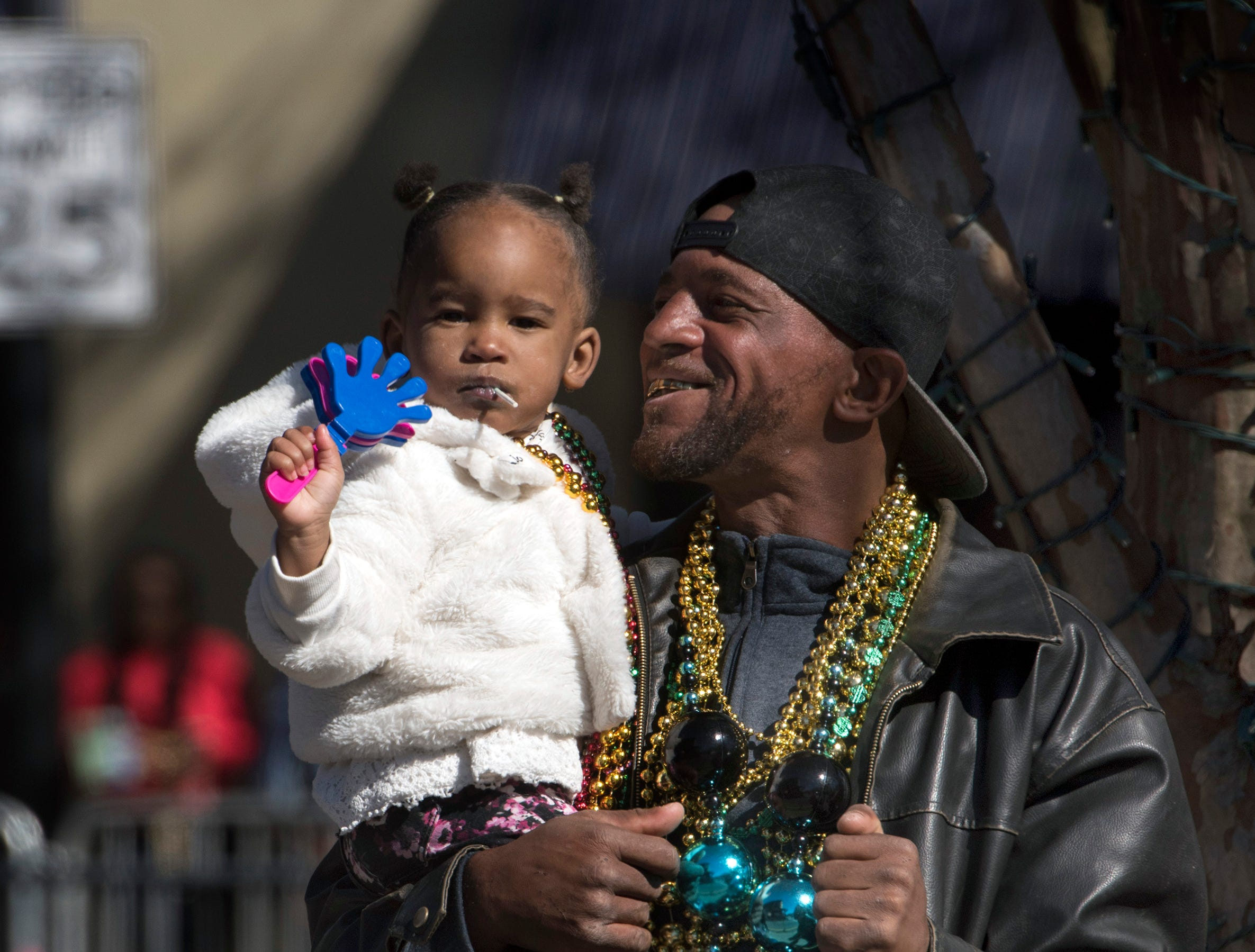 Christopher Stallworth and his granddaughter, Janiyah Stallworth, enjoy the sights and the sounds on annual Martin Luther King, Jr. parade in downtown Pensacola on Monday, Jan. 21, 2019.