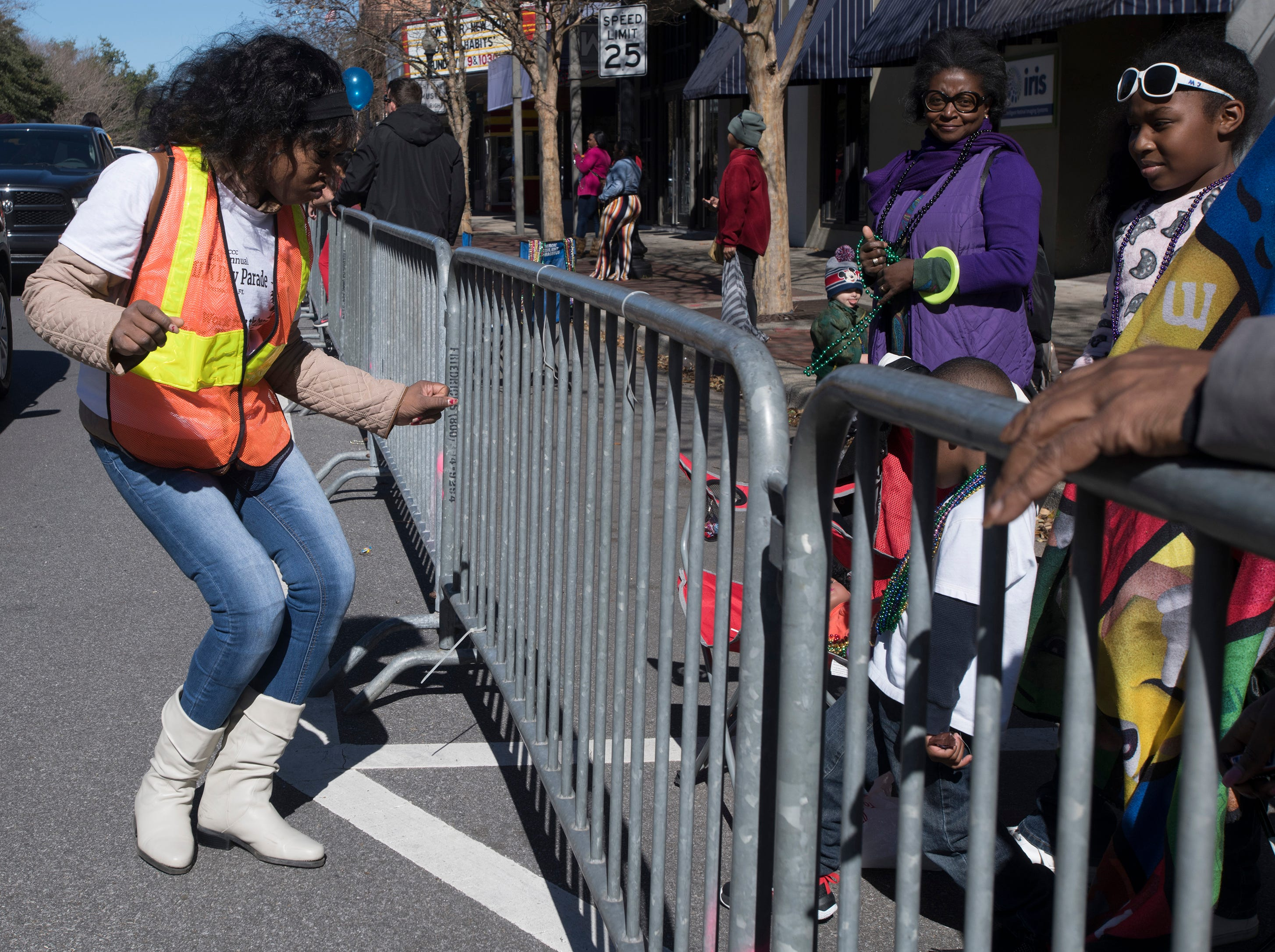 Maya Porter entertains the spectators watching with a soft shoe dance during the annual Martin Lunter King, Jr. Parade in downtown Pensacola on Monday, Jan. 21, 2019.