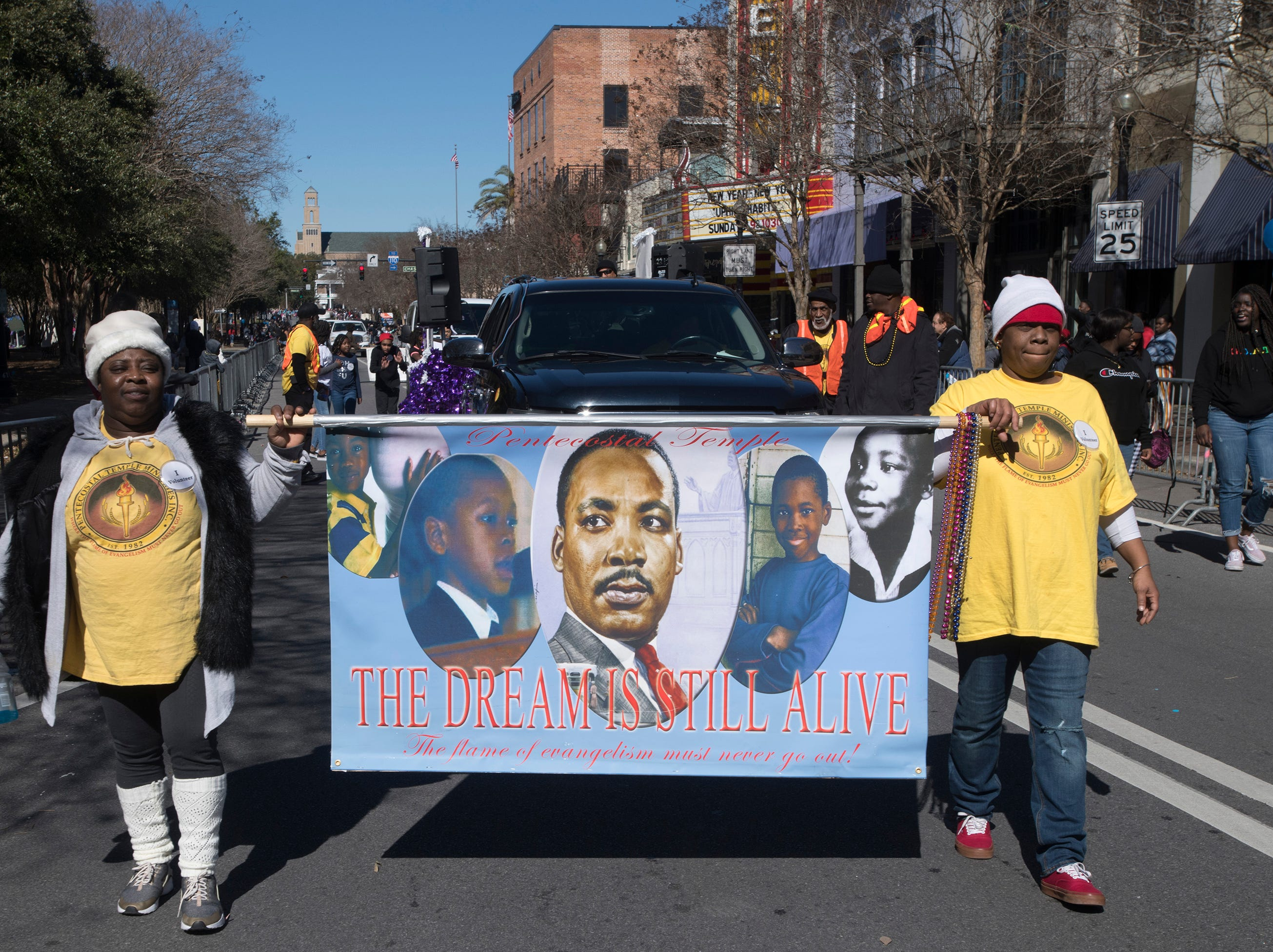 Pentecostal Temple volunteers Jadorhia Hand and Lakeresha Jackson march in the annual Martin Luther King, Jr. parade in downtown Pensacola on Monday, Jan. 21, 2019.